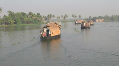Kerala backwaters houseboats cruising s1 Stock Footage