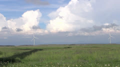 Row of  wind turbines generating clean  energy in the countryside - stock footage