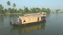 Kerala backwaters houseboat turning s Stock Footage