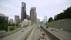 City buildings skyline and freeway commuter car traffic - stock footage