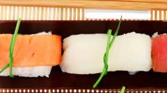 Traditional japanese nigiri sushi on bamboo mat Stock Footage