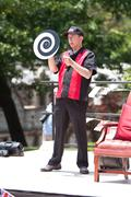 Magician performs visual illusion at spring festival Stock Photos