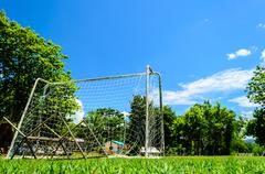 Behind of the mini football goal in college Stock Photos