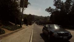 Streets of Hollywood cars travelling pass camera cutaway transition  Stock Footage