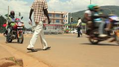 Busy pedestrian and traffic flow on African street Stock Footage