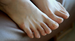 Close up shot of bare foot tapping Stock Footage