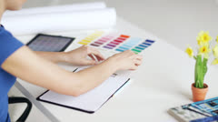 Woman with color samples for selection Stock Footage