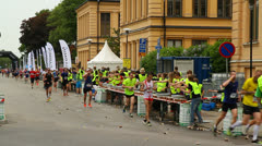 Refreshing with drinks in Stockholm marathon Stock Footage