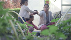 Woman teaching children planting Stock Footage