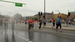 Stockholm Marathon, running under a shower Stock Footage