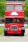 big red double decker bus on the street - stock photo