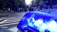 Occupy Frankfurt demonstration police flashing blue light Stock Footage