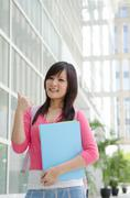 a portrait of an asian college student on campus - stock photo