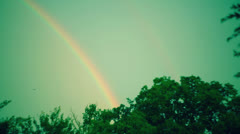 Rainbow in sky double Stock Footage