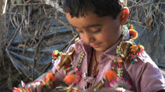 India Rajasthan Luni boy sports two necklaces zoom 1 Stock Footage