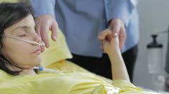 man holds the hand of his wife in the hospital - stock footage