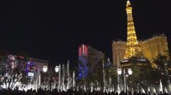 Bellagio fountain and Paris resort by night, Las Vegas Strip, Las Vegas, Nevada, Stock Footage