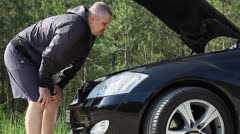 Man near the car with an open hood episode 1 Stock Footage