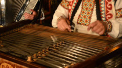 Playing  instrument dulcimer Stock Footage