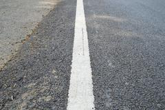 close up road divide white line - stock photo