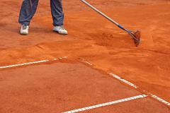 Preparation  tennis court - stock photo
