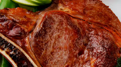 Meat food : grilled beef spare rib on white dish Stock Footage