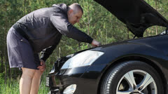 Man near the car with an open hood episode 2 Stock Footage
