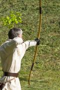 Man shoots and classic bow Stock Photos