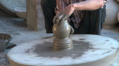 India Rajasthan Luni potter shapes vase with fingers zoom out 7 Stock Footage
