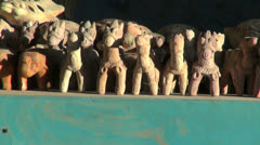 India Rajasthan Luni pottery studio figures aligned on table 8 Stock Footage