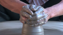India Rajasthan Luni potter shapes a vase with clay coated hands 9 Stock Footage