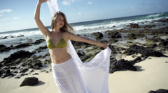 Stock footage Hawaii- beautiful girl on beach with silk in slo motion Stock Footage