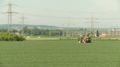 Tractor spraying on field Stock Footage