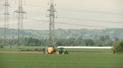 Tractor pesticide spraying on field Stock Footage