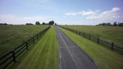 Flight down country road - stock footage