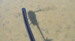 Helicopter Shadow on Water POV of Helicopter Passenger Stock Footage
