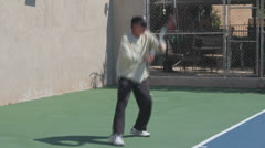 Mature Tennis Pro - slow motion powerful forehand close Stock Footage