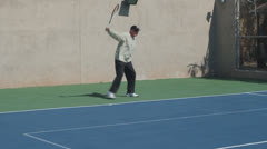 Mature Tennis Pro - backhand get ready forehand get ready Stock Footage