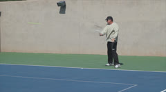 Mature Tennis Pro - bad forehand return into the ground Stock Footage