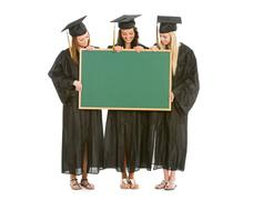 graduation: group of girl graduates hold blank chalkboard - stock photo