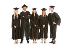 graduation: recent graduates in a row - stock photo