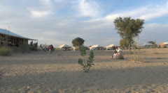 India Rajasthan Manvar camp tents and sleeping camel  Stock Footage