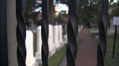 Closeup Cemetary Through Fence in Daylight HD Video - stock footage