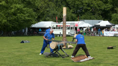 Sawing logs at Highclere Country Fair (1) slow motion Stock Footage