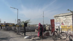 India Rajasthan Jaisalmer station woman steps over train switch  Stock Footage
