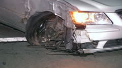 Sedan With Damage To Front Right Wheel Stock Footage