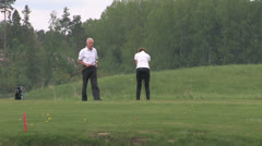 2 people playing golf Stock Footage