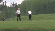Stock Video Footage of 2 people playing golf