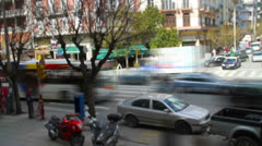 Time lapse video of commuters and car traffic, Tilt shift Stock Footage