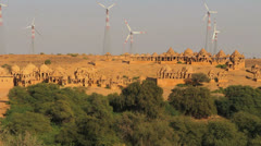India Rajasthan Jaisalmer ring of golden Cenotaphs and windmills  Stock Footage